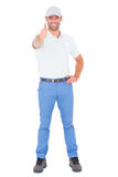 Portrait of confident handyman gesturing thumbs up Stock Photos