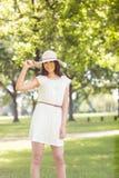 Portrait of confident happy woman holding sun hat Stock Photos