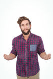 Portrait of confident hipster with clenched fist. Against white background Stock Images