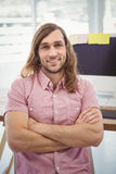 Portrait of confident hipster at computer desk Stock Photography