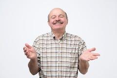 Confident hispanic mature man laughing and smiling stock photos