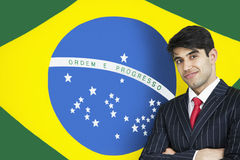 Portrait of a confident Indian businessman against Brazilian flag Stock Image