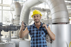 Portrait of confident industrial worker holding wrench Royalty Free Stock Photo
