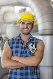 Portrait of confident industrial worker standing arms crossed Stock Images