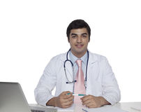 Portrait of confident junior medical doctor,siting at the desk and working Royalty Free Stock Photography