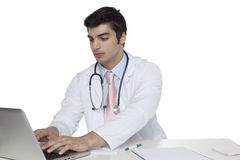 Portrait of confident junior medical doctor,siting at the desk and working Royalty Free Stock Image