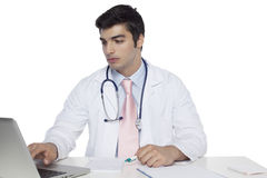 Portrait of confident junior medical doctor,siting at the desk and working Stock Images