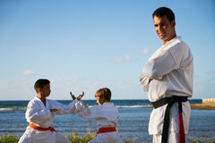 Portrait Of Confident Karate Trainer Watching Children Fight Royalty Free Stock Photo