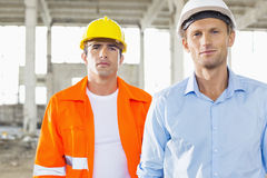 Portrait of confident male architects at construction site Stock Photography