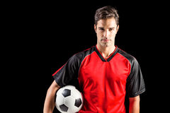 Portrait of confident male athlete holding football Royalty Free Stock Image