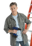 Portrait Of Confident Male Carpenter Holding Drill. While standing against white background Stock Image