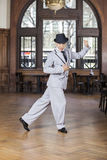 Portrait Of Confident Male Dancer Performing Tango. Full length portrait of confident male dancer performing tango in restaurant Stock Image