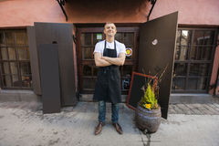 Portrait of confident male salesperson standing arms crossed outside coffee store stock photos