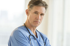 Portrait Of Confident Male Surgeon. Portrait of confident mature male surgeon in hospital Stock Image