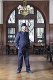 Portrait Of Confident Male Tango Dancer Standing In Restaurant. Full length portrait of confident male tango dancer standing with hands in pockets in restaurant Stock Photo