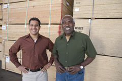 Portrait Of Confident Male Warehouse Workers Royalty Free Stock Images