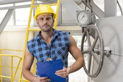 Portrait of confident male worker holding clipboard in industry Royalty Free Stock Photography