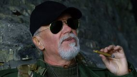 Portrait of confident man with cigar Stock Photo