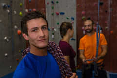 Portrait of confident man with climbing rope in gym Stock Image