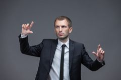 Portrait of confident manager pointing hand gestures Stock Photos