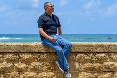 Portrait of a confident mature businessman sitting outside. royalty free stock photography