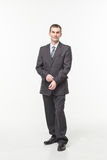 Portrait of confident mature businessman standing isolated over white background royalty free stock photos
