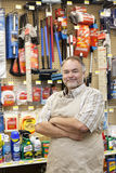 Portrait of a confident mature salesperson with arms crossed in hardware store Royalty Free Stock Photography