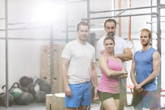 Portrait of confident men and women standing at crossfit gym royalty free stock image