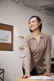 Portrait of confident mid adult businesswoman in the office Royalty Free Stock Image