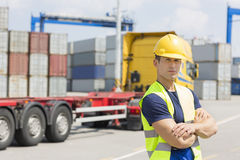 Portrait of confident mid adult man in shipping yard Royalty Free Stock Photo