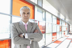Portrait of confident middle aged businessman at railroad station Stock Photo