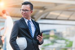 Portrait of confident modern young businessman wear black suit hand holding digital tablet. Stock Photography