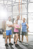 Portrait of confident people standing at crossfit gym Royalty Free Stock Images