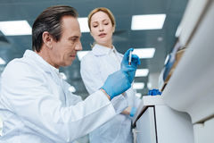 Portrait of confident practitioner while examining DNA Stock Images