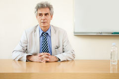 Portrait of confident professor in classroom Royalty Free Stock Images