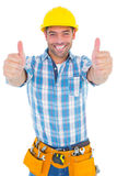 Portrait of confident repairman gesturing thumbs up Stock Photo