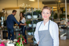 Portrait Of Confident Salesperson In Flower Shop Stock Photos