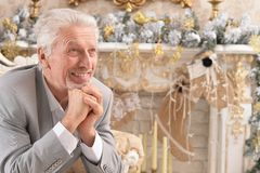 Portrait of a confident senior businessman sitting in chair royalty free stock photography