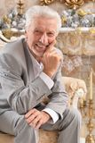 Portrait of a confident senior businessman sitting in chair stock photo
