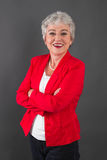 Portrait of confident senior woman in red jacket Stock Images