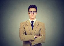 Portrait of a confident serious young business man. Confident serious young business man in glasses looking at camera Stock Image