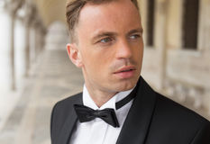 Portrait of confident sexy man in tuxedo and bow tie Stock Images