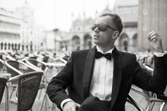 Portrait of confident sexy man in tuxedo and bow tie Royalty Free Stock Images