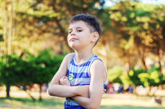 Portrait of a confident six year old boy in the park, Looking Di Royalty Free Stock Image