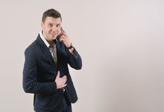 Portrait of confident smiling businessman talking on the phone Stock Photo