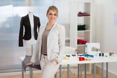 Portrait of confident smiling fashion designer royalty free stock image