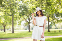 Portrait of confident smiling woman holding sun hat Stock Images