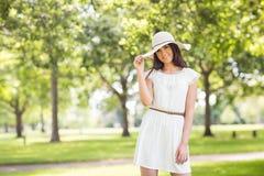 Portrait of confident smiling woman holding sun hat Stock Images