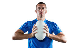 Portrait of confident sports player in blue jersey holding ball Stock Image