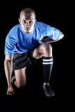 Portrait of confident sportsman kneeling Stock Images